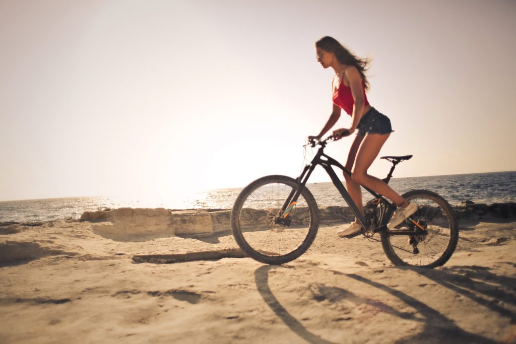 Woman riding a mountain terrain bike (MTB)