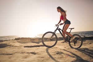 Woman riding a mountain terrain bike