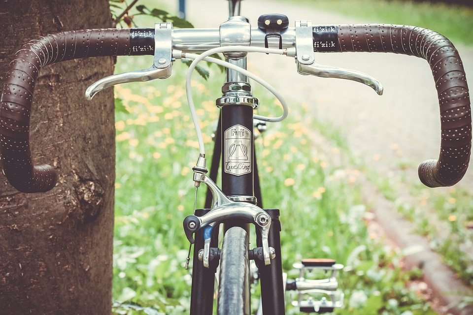Bicycle frame and bike brakes on the pavement