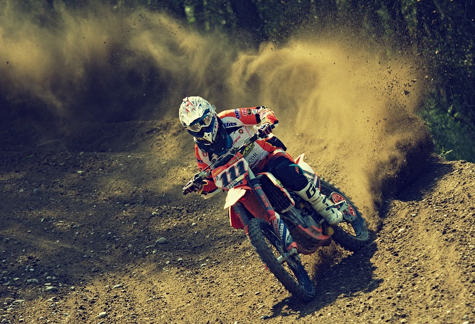 A rider riding a motocross bike - Motor Sport