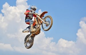 A rider jumping with a dirt bike