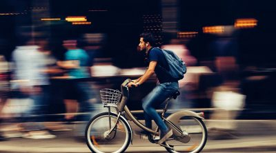 A man riding an e-bike in the city