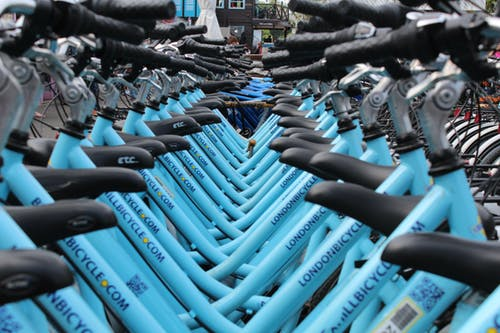 Blue bikes on a bike rack